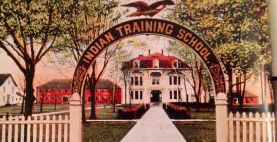 """Most schools entrances were decorated with archways to symbolize this change from an """"uncivilized"""" to a """"civilized world."""" """"Indian Training School,"""" 1886. Courtesy of Harvey W. Scott Memorial Library, Pacific University Archives."""